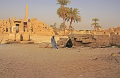 Egyptian workers resting at Karnak temple complex, Luxor Stock Photography