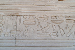 Egyptian writing on the wall of the temple in Luxor Stock Photography