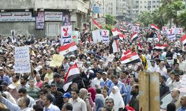 Egyptians demonstrating against Military Council stock photos