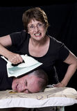 Ehemann und Frau mit Eisen Stockbild