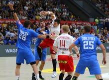 EHF EURO 2020 Qualifiers handball game Ukraine v Denmark. KYIV, UKRAINE - JUNE 12, 2019: Ukraine in Blue and Denmark handball players fight for a ball during stock image