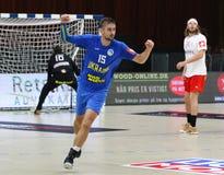 EHF EURO 2020 Qualifiers handball game Ukraine v Denmark. KYIV, UKRAINE - JUNE 12, 2019: Oleksandr TILTE of Ukraine reacrs after scored a goal during the EHF stock photography