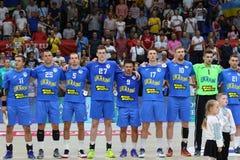 EHF EURO 2020 Qualifiers handball game Ukraine v Denmark. KYIV, UKRAINE - JUNE 12, 2019: Players of Ukraine National handball team listen to national anthem royalty free stock photography