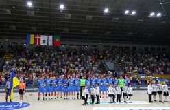 EHF EURO 2020 Qualifiers handball game Ukraine v Denmark. KYIV, UKRAINE - JUNE 12, 2019: Players of Ukraine National handball team listen to national anthem royalty free stock photo