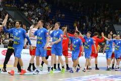 EHF EURO 2020 Qualifiers handball game Ukraine v Denmark. KYIV, UKRAINE - JUNE 12, 2019: Players of Ukraine and Denmark National handball teams cheer each other royalty free stock photos