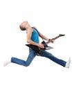 Ehrfürchtiger Gitarrenspieler springt lizenzfreies stockbild