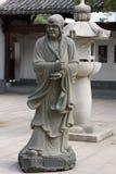 Ehrwürdige schnitzen-große Steinstatue achtzehn Lizenzfreie Stockfotos