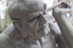 Ehrwürdige schnitzen-große Steinstatue achtzehn Stockfoto