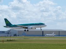 EI-CVA Aer Lingus Airbus A320 landing on the Buitenveldertbaan 09-27 landing strip royalty free stock photo