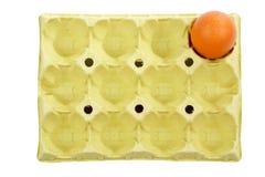 Ei in einem Kasten Stockbild
