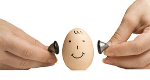 Ei met menselijke gezicht en hoofdtelefoons stock afbeeldingen