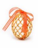 Ei met rood lint Royalty-vrije Stock Fotografie