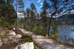Eibsee lake path germany with the zugspitze mountain range in the background Stock Image