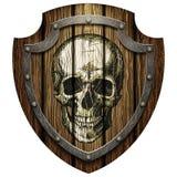 Eichenschild mit Schädel- und Metallbolzen Stockfotos