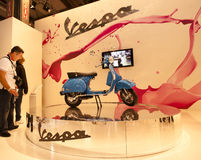 EICMA 2010 - Vespa stand. MILAN, NOVEMBER 3: Vespa stand at EICMA, 68th International Bicycle and motorcycle Exhibition in Milan Fair, November 2nd - 7th, 2010 Royalty Free Stock Photography