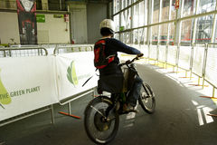 EICMA 2010 - Visitor testing an electric bicycle Royalty Free Stock Photo