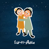Eid-Al-Adha celebration with stylish text and mosque. Cute little kids hugging and giving wishes to each other on seamless background for muslim community Stock Photos