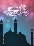 Eid-Al-Adha celebration with stylish text and mosque. Stock Photos