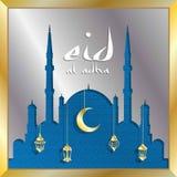 Eid-Al adha Grußkarte mit silbernen Moscheen- und Goldlaternen f lizenzfreies stockfoto
