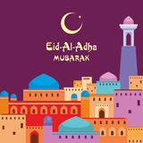 Eid al Adha mubarak. Eid al-Adha greeting card   with the image of an ancient middle Eastern city with mosques and minarets Stock Photos