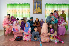 Eid Al-Fitr. Batu Pahat, Malaysia - June 25th , 2017:  Muslim family in traditional Malay clothing during Eid al-Fitr celebration at  Batu Pahat , Malaysia Stock Image