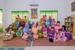 Eid Al-Fitr. Batu Pahat, Malaysia - June 25th , 2017:  Muslim family in traditional Malay clothing during Eid al-Fitr celebration at  Batu Pahat , Malaysia Stock Photo