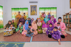Eid Al-Fitr. Batu Pahat, Malaysia - June 25th , 2017:  Muslim family in traditional Malay clothing during Eid al-Fitr celebration at  Batu Pahat , Malaysia Royalty Free Stock Photo