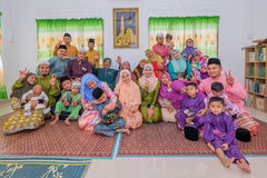Eid Al-Fitr. Batu Pahat, Malaysia - June 25th , 2017:  Muslim family in traditional Malay clothing during Eid al-Fitr celebration at  Batu Pahat , Malaysia Stock Photos