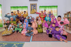 Eid Al-Fitr. Batu Pahat, Malaysia - June 25th , 2017:  Muslim family in traditional Malay clothing during Eid al-Fitr celebration at  Batu Pahat , Malaysia Royalty Free Stock Photography