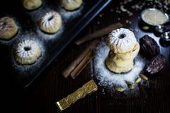Eid maamool معمول. Date arabian traitional eid cookies for ramadan and holidays with icing sugar Stock Photos