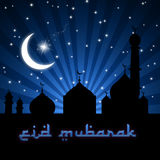 Eid Mosque Blue Night. Eid Greeting illustration with silhouettes of the moon, stars and a mosque on a blue night sky Royalty Free Stock Photos