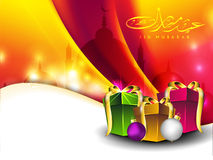 Eid Mubarak background. Arabic Islamic calligraphy of golden text Eid Mubarak with gift boxes on colorful wave background for Eid festival. EPS 10 Stock Image