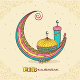 Eid Mubarak celebration with colorful moon and mosque. Royalty Free Stock Images