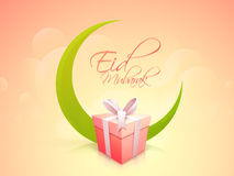 Eid Mubarak celebration with creative moon and gift. Glossy gift box with green crescent moon on shiny colorful background for muslim community festival, Eid Stock Photography
