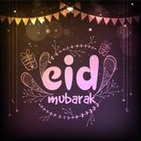 Eid Mubarak celebration with glossy text. Royalty Free Stock Images
