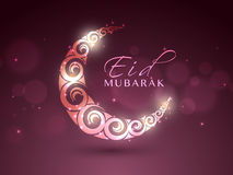 Eid Mubarak celebration with shiny creative moon. Stock Images
