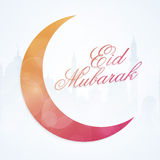 Eid Mubarak celebration with shiny crescent moon. Royalty Free Stock Photo