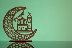 Eid Mubarak concepts with crescent moon in silhouette with mosque