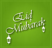 Eid Mubarak on green background with hanging lamps Royalty Free Stock Photos