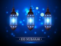 Eid Mubarak greeting on blurred background with beautiful illuminated. Arabic lamp and hand drawn calligraphy lettering Royalty Free Stock Photography