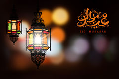 Eid Mubarak. Greeting on blurred background with beautiful illuminated arabic lamp and hand drawn calligraphy lettering. Vector illustration royalty free illustration