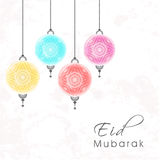 Eid Mubarak Greeting Card avec les lampes accrochantes Image libre de droits