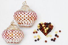 Eid Mubarak greeting with Eid Al Adha sacrifice festival, Islamic Arabic candle and sweet chocolate sugars stock images