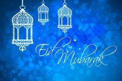 Eid Mubarak greeting for Islamic Holidays, Eid Al-Fitr and Eid A. L-Adha. Blue background with silhouette of white lanterns vector illustration