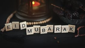 Eid Mubarak Greeting Scrabble Letters. Ramadan Candle Lantern wi. Th Wooden Prayer Beads and Dates Stock Images