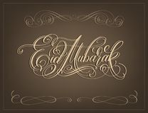 Eid Mubarak hand lettering calligraphy text to islamic holiday Royalty Free Stock Photography
