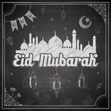 Eid Mubarak (Happy Eid) on chalkboard background Royalty Free Stock Photography