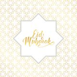 Eid Mubarak. Ramadan Islamic background. Gold Arabesque pattern and lettering calligraphy Royalty Free Stock Photo