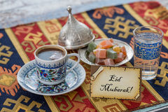 Eid mubarak text  on greeting card with turkish coffee, delights Stock Photo