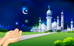 Eid Prayer. Illustration of praying hand in front of mosque in Eid night Stock Images